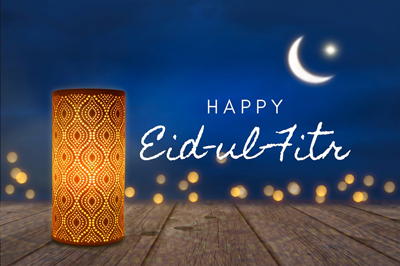 Happy eid ul fitr text with image of lantern.
