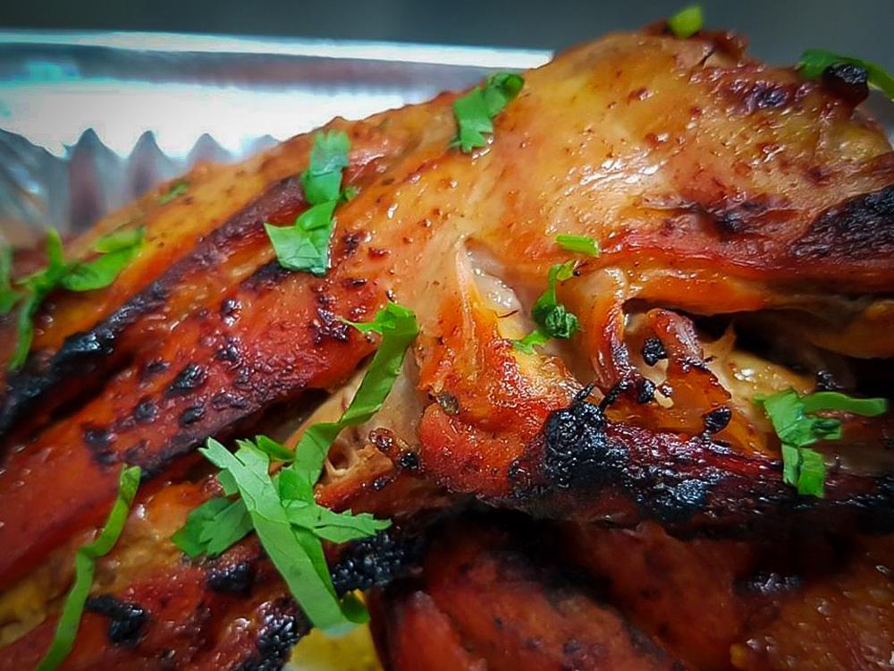 Chicken tikka with coriander shavings.