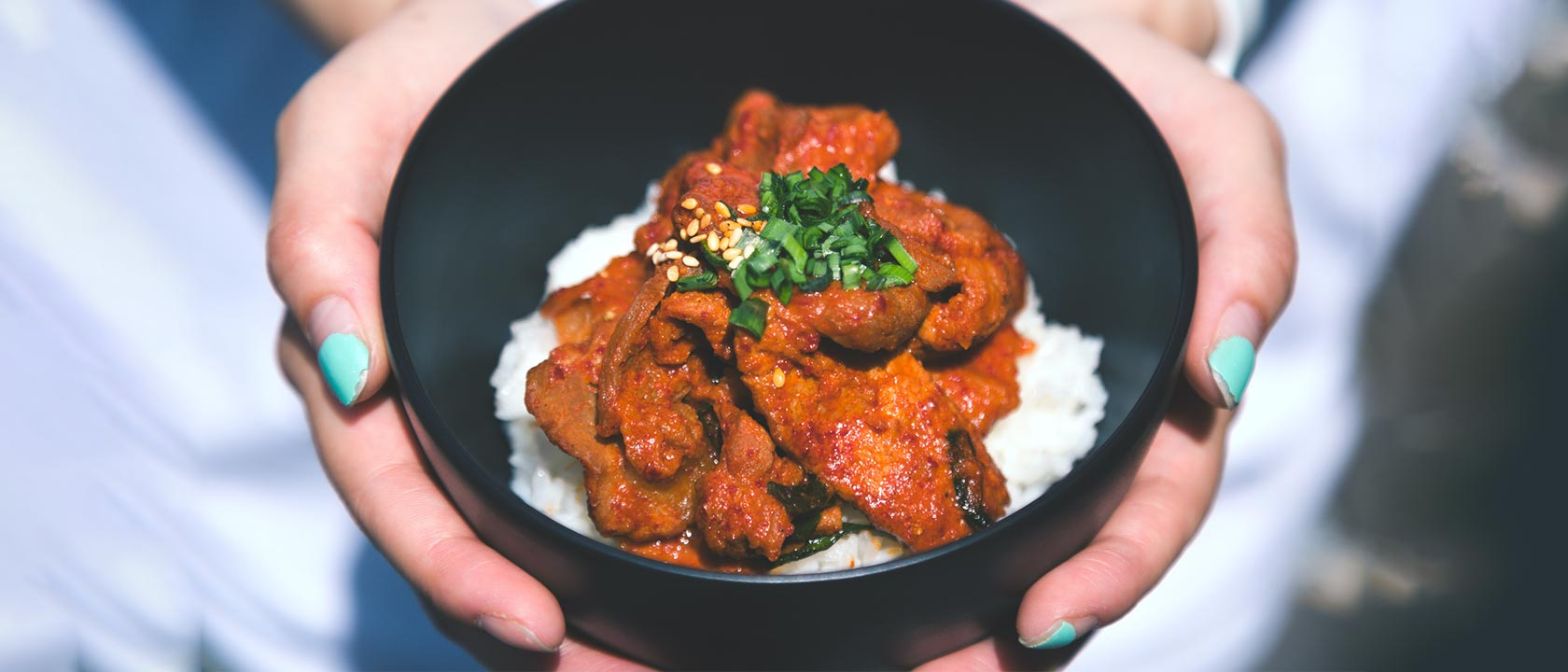 Close up of lady holding home made curry.