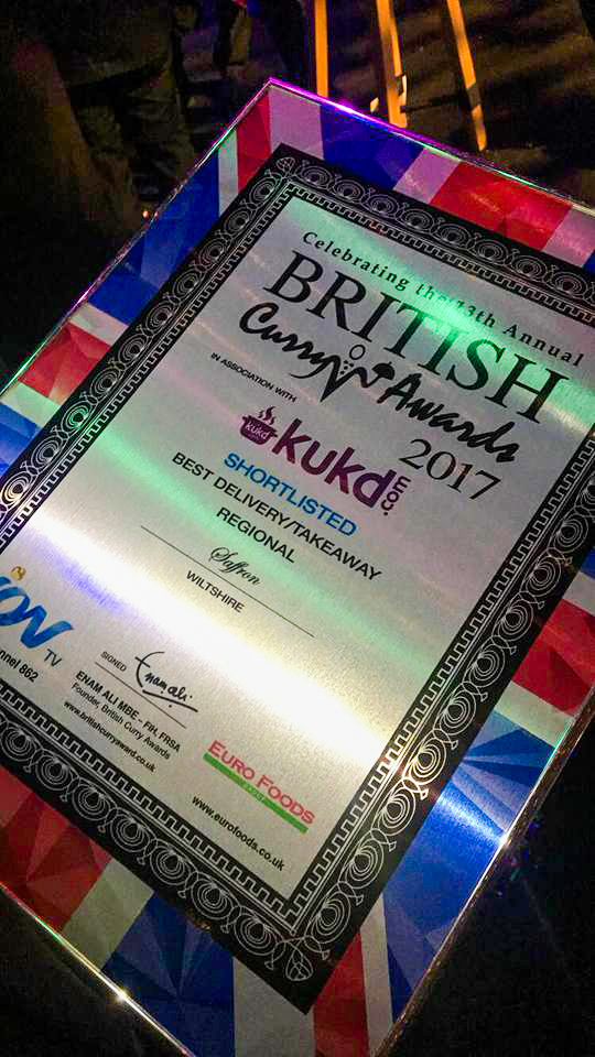 An award that is framed with the british flag.