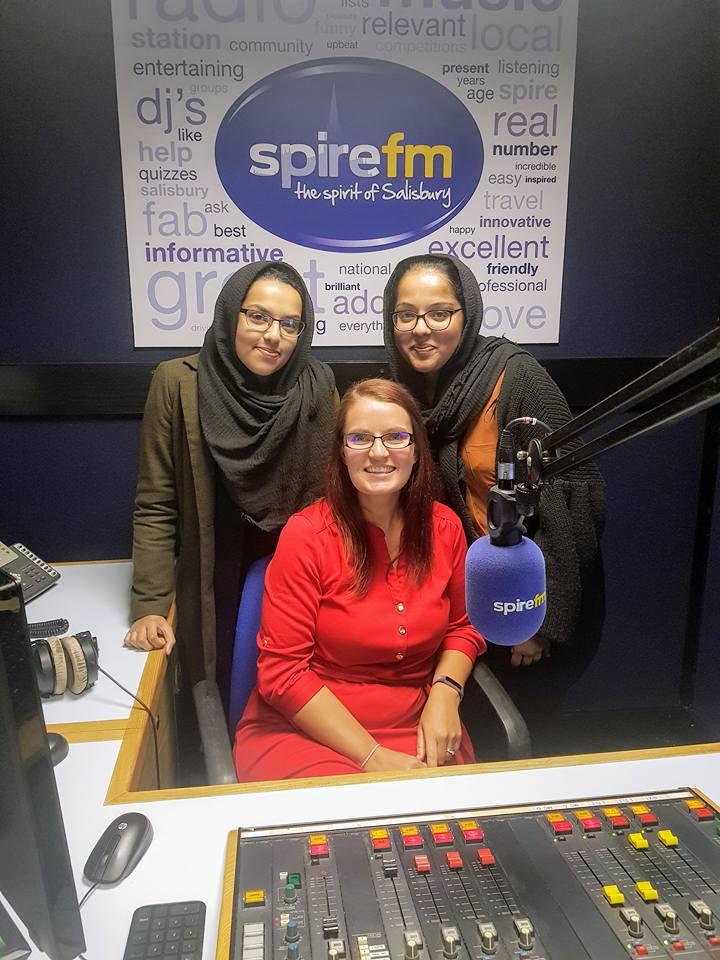 Three women inside a radio station